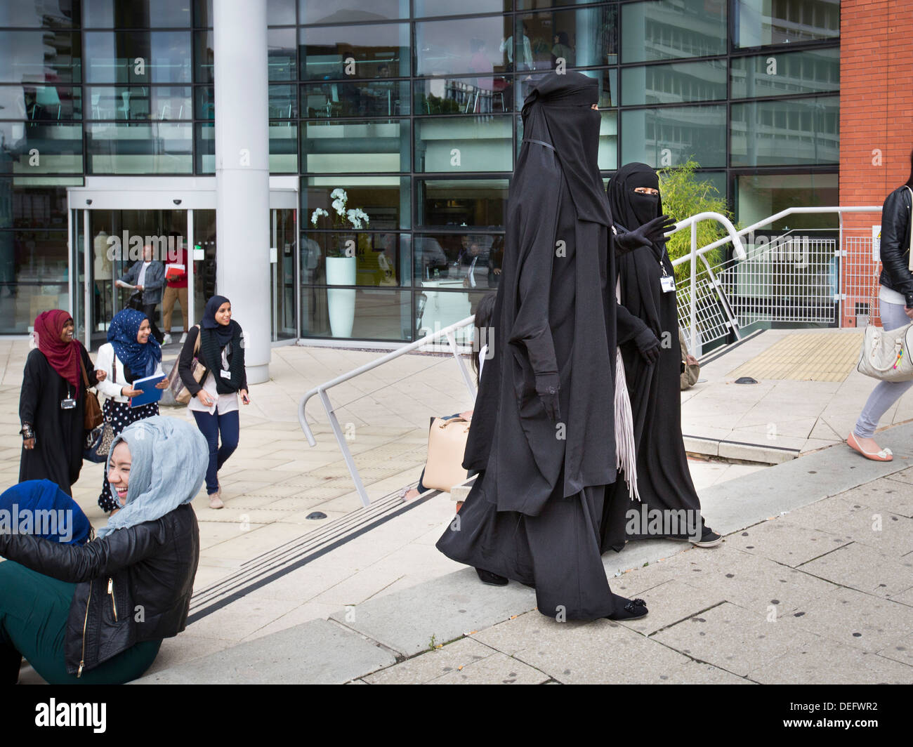 Two college students dressed in burkas in Birmingham, UK. They are students at Birmingham Metropolitan College. - Stock Image