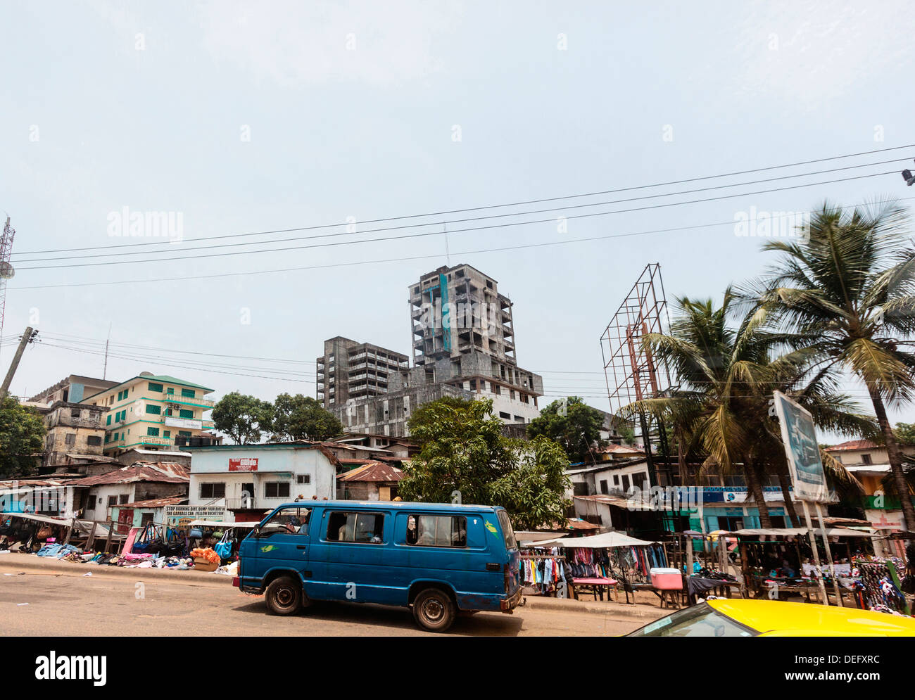 Africa, Liberia, Monrovia. Van passing by busy city market. Stock Photo