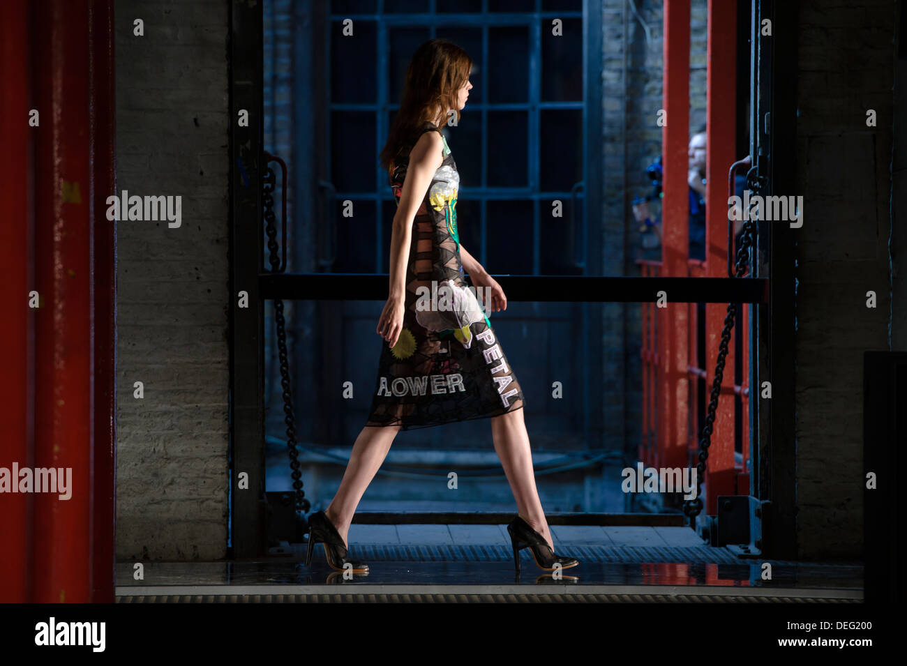 A model wears a design created by Christopher Kane during London Fashion Week Spring/Summer 2014. - Stock Image