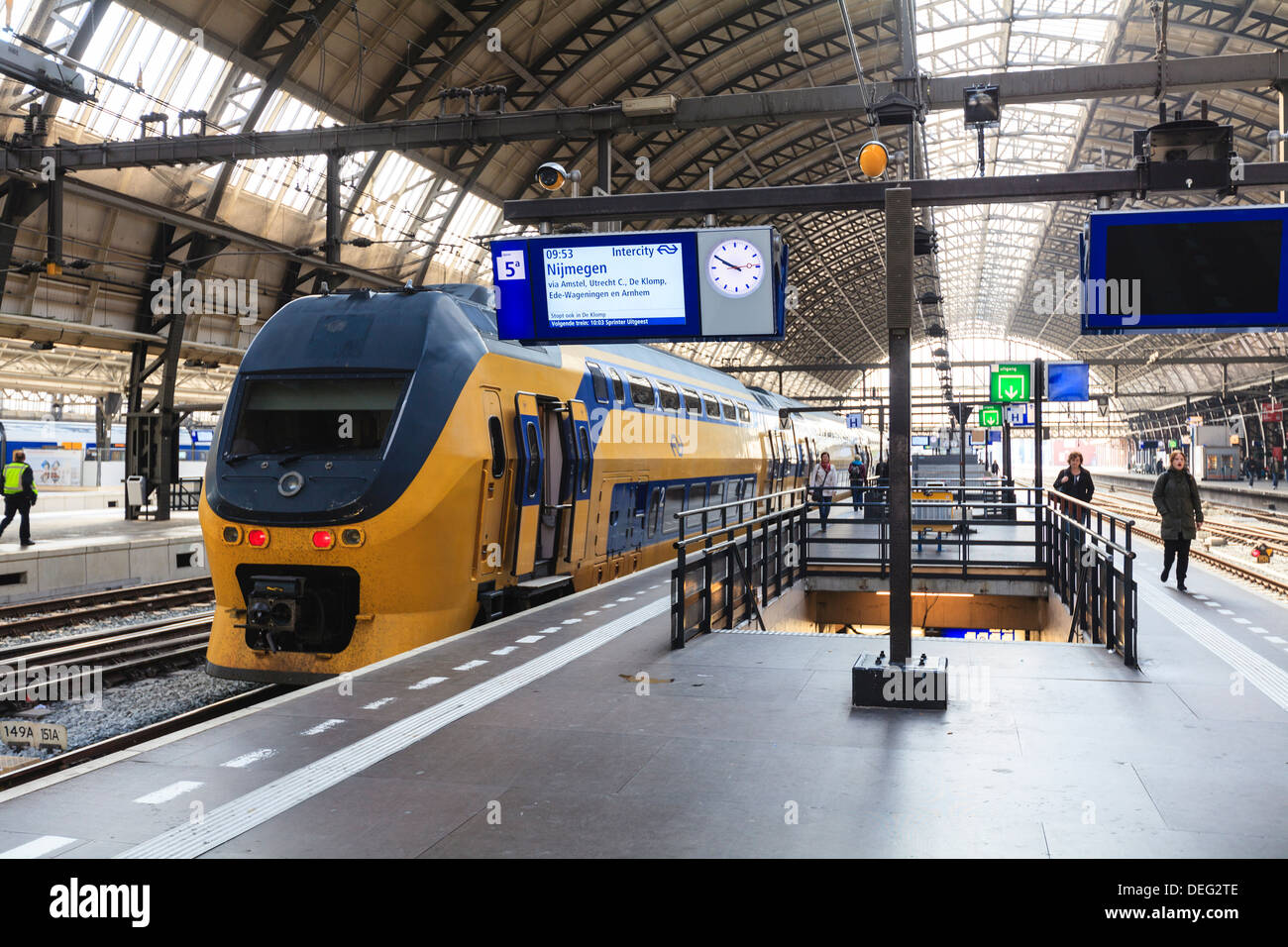 Intercity train in a platform at Central Station, Amsterdam, Netherlands, Europe - Stock Image