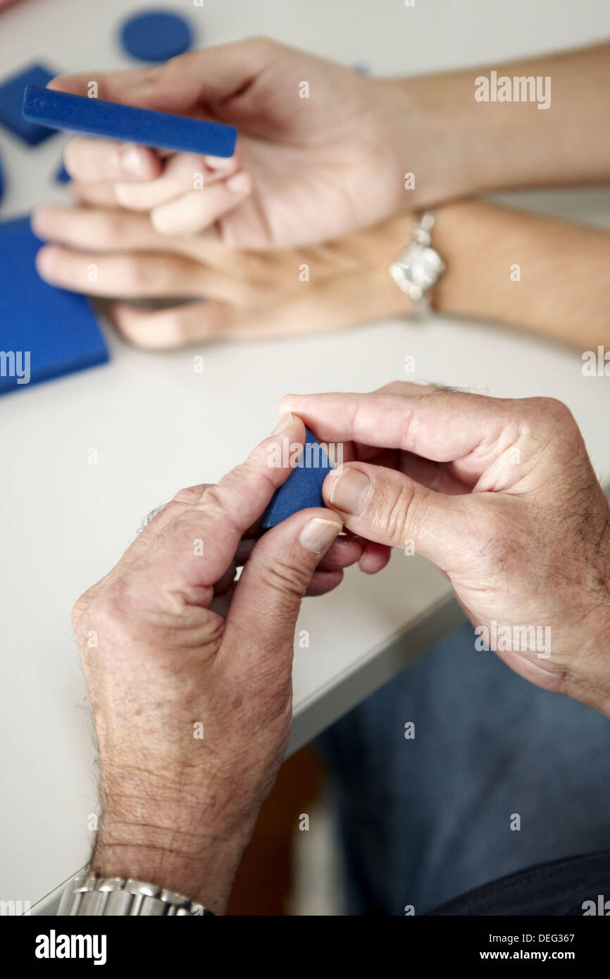 Occupational therapy, geometric forms: shape and texture recognition exercise, exteroception. Hospital Universitario de Gran - Stock Image