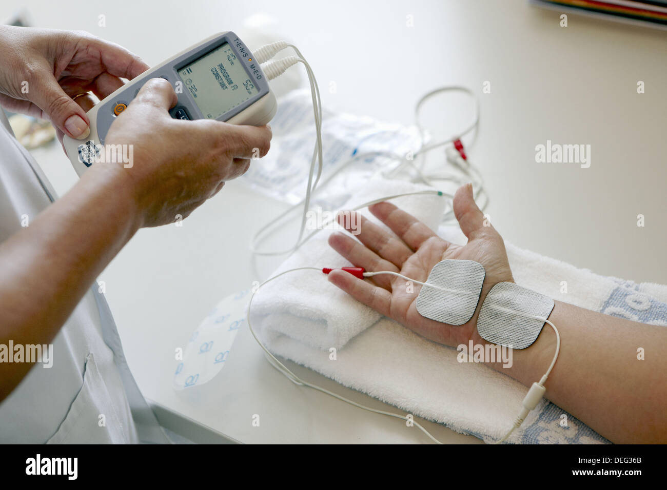 Rehabilitation, application of electrical current through the skin for pain control. Hospital Universitario de Gran Canaria - Stock Image