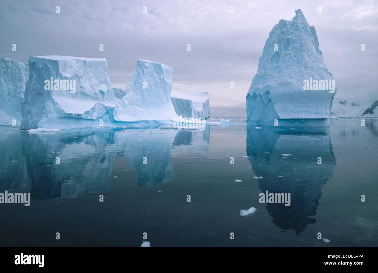 Iceberg in reflection. Andvoord Bay. Antarctic Peninsula.  Antartica Stock Photo