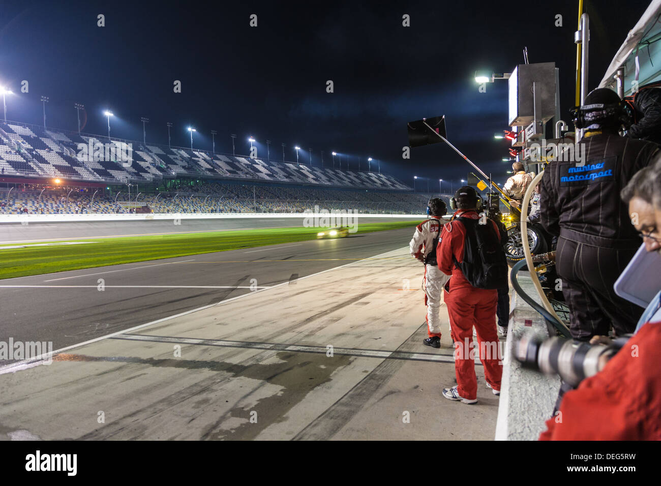 Pit road at night at Daytona International Speedway during the 2012 Rolex 24 at Daytona, Florida - Stock Image