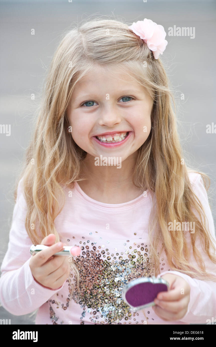 Pretty young child (aged 6)  dressed in pink. - Stock Image