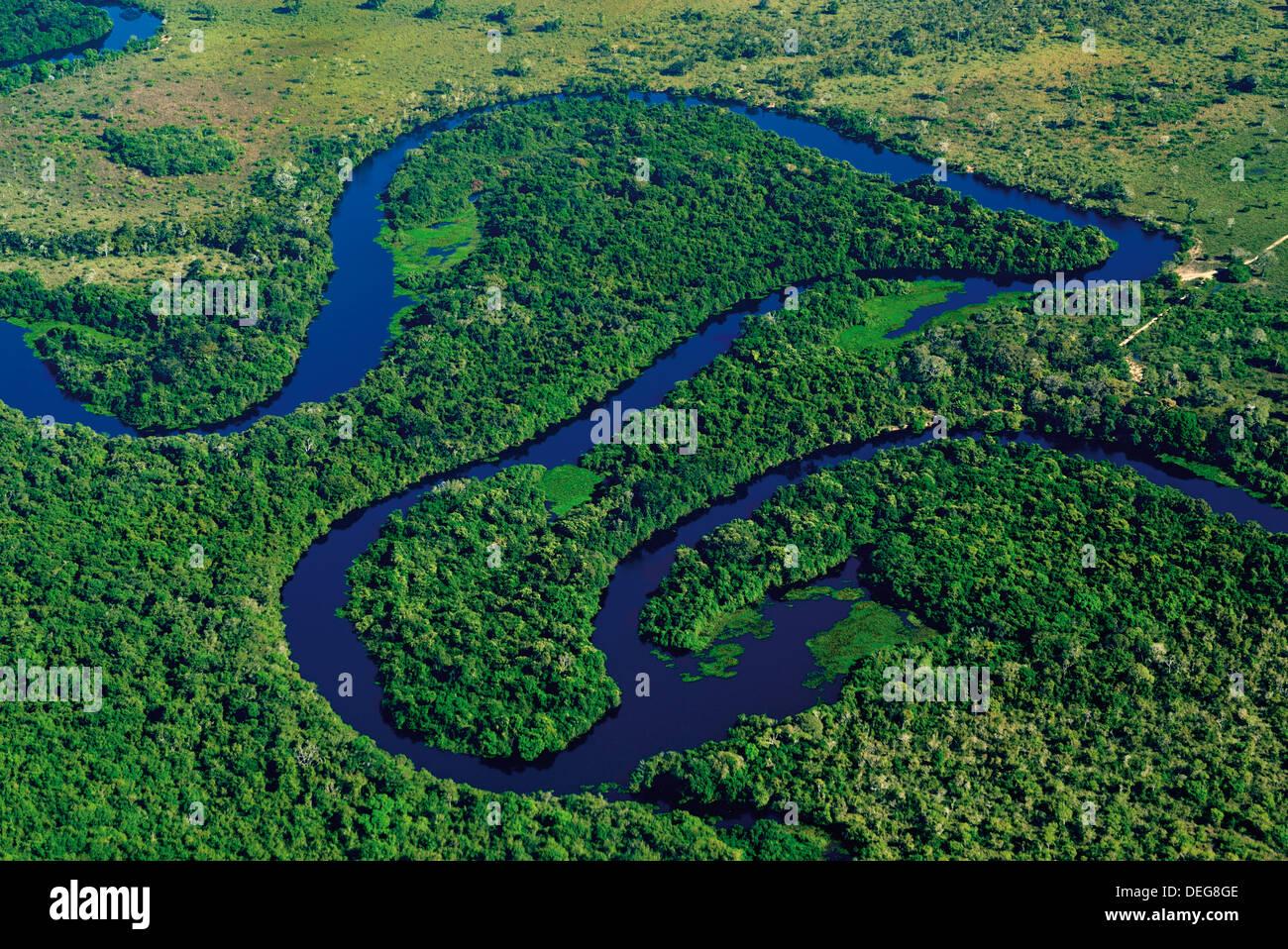 Brazil, Pantanal: Aerial shot of river Claro and rain forest near Poconé - Stock Image
