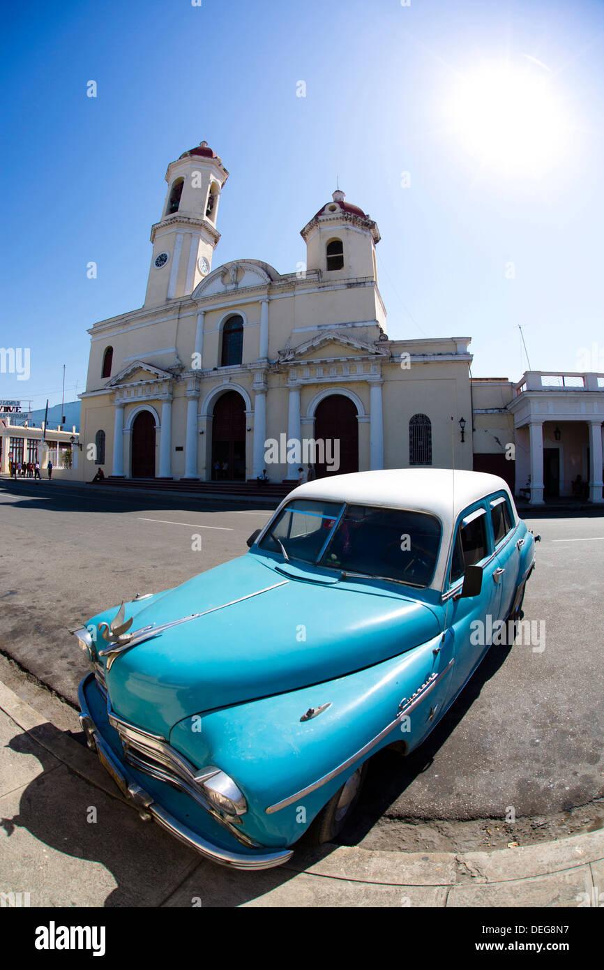 Fisheye image of vintage American car and church, Parc Jose Marti, Cienfuegos, UNESCO World Heritage Site, Cuba, West Indies - Stock Image