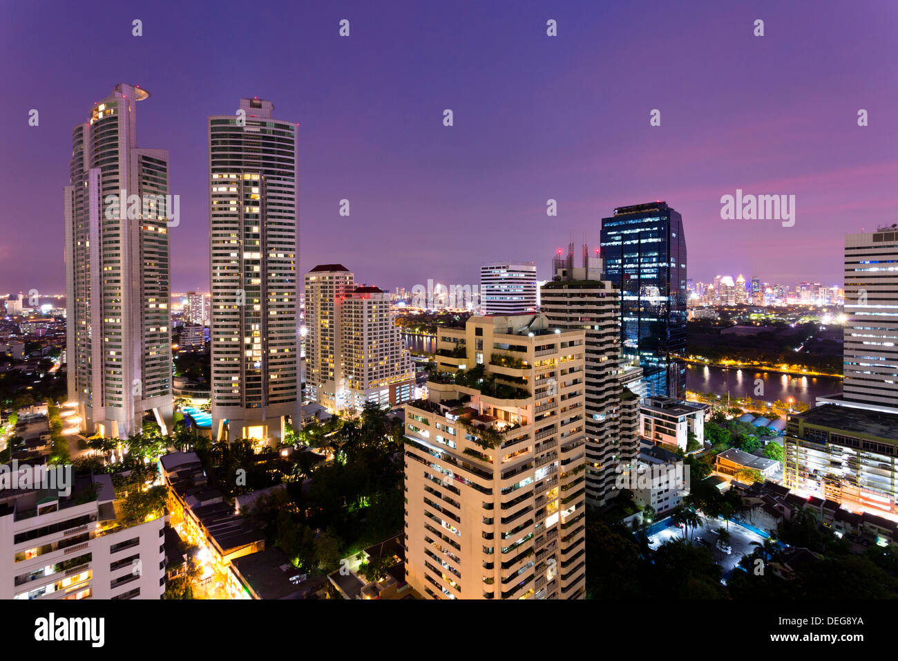 High rise buildings of Bangkok at night from Rembrandt Hotel and Towers, Sukhumvit 18, Bangkok, Thailand, Southeast Asia, Asia - Stock Image
