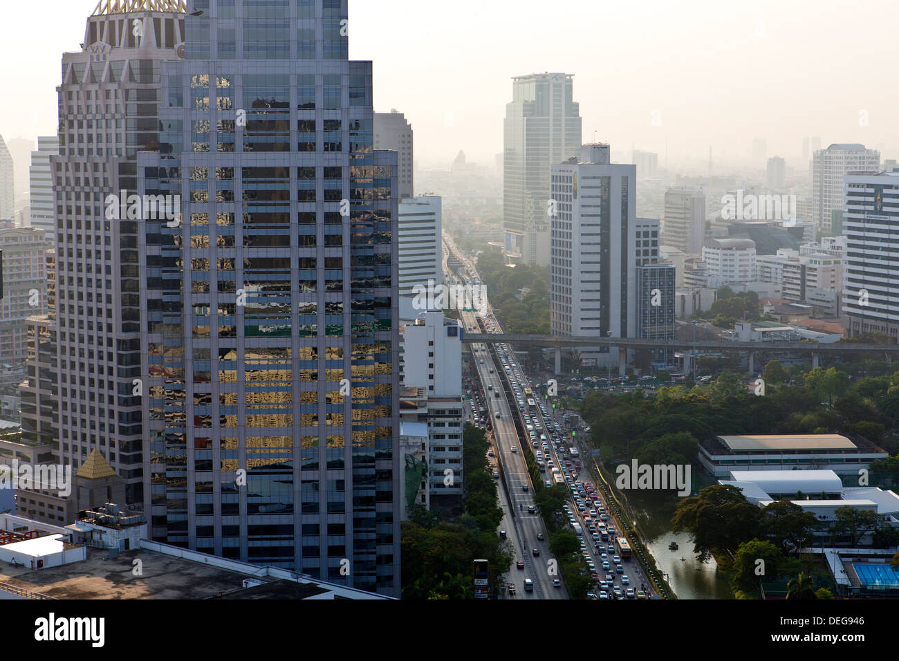 High rise buildings and traffic congestion on Rama IV in evening light, Sathorn Road, Bangkok, Thailand - Stock Image