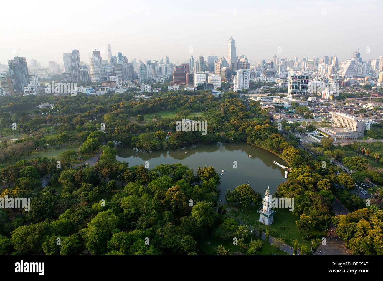 City skyline with Lumphini Park, the Green Lung of Bangkok, in the foreground, Sathorn Road, Bangkok, Thailand - Stock Image