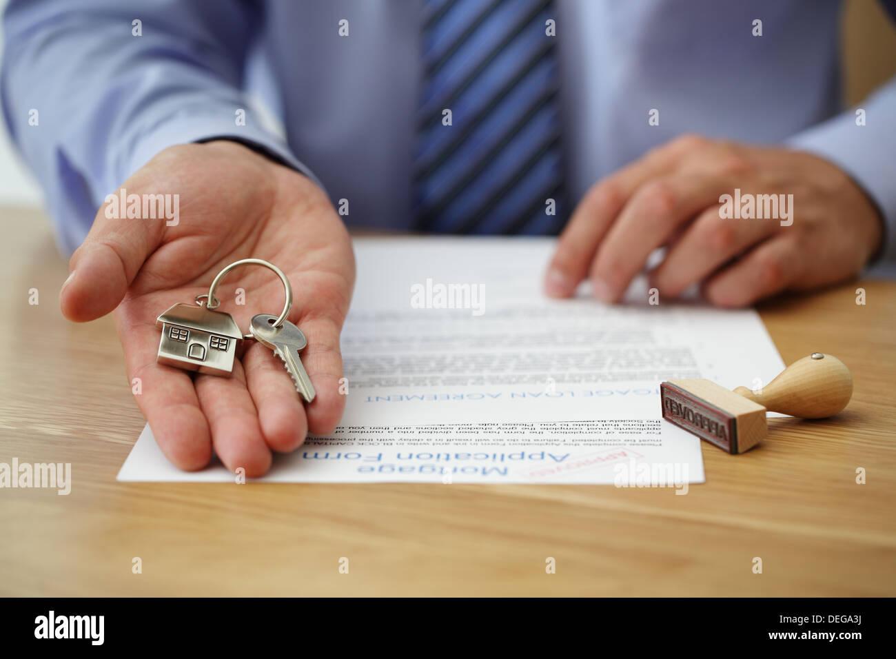 Handing over house keys - Stock Image