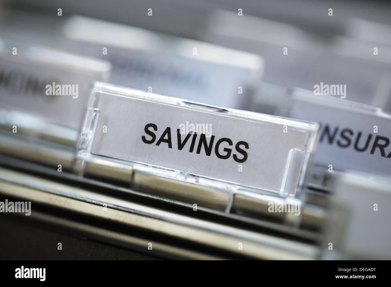 Savings heading in filing cabinet - Stock Image