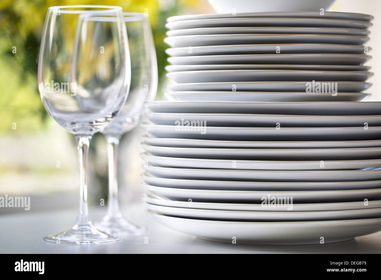 White plates and wine glasses - Stock Image