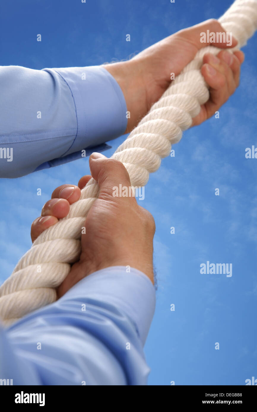 Climbing a rope - Stock Image