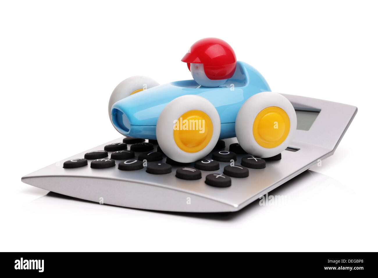 Calculator and toy car - Stock Image