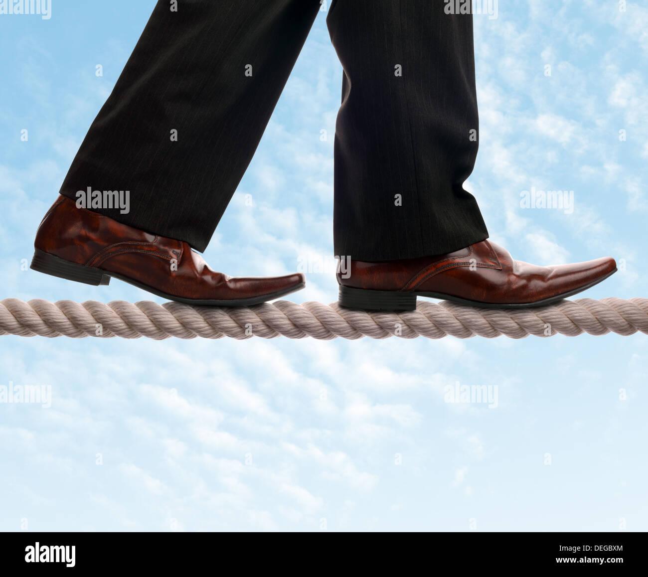 Tightrope walker businessman - Stock Image