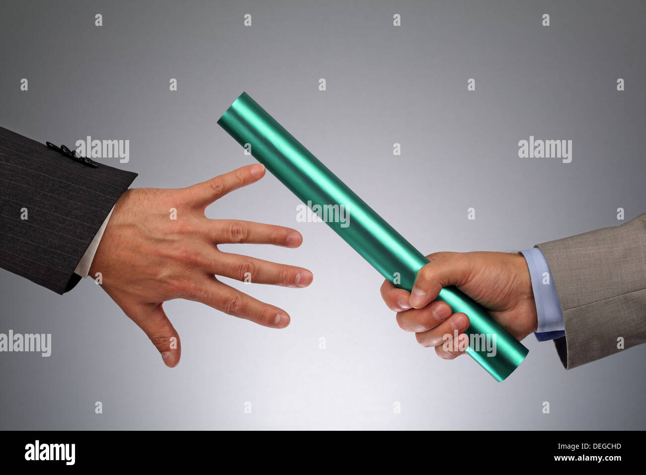 Teamwork passing the baton - Stock Image