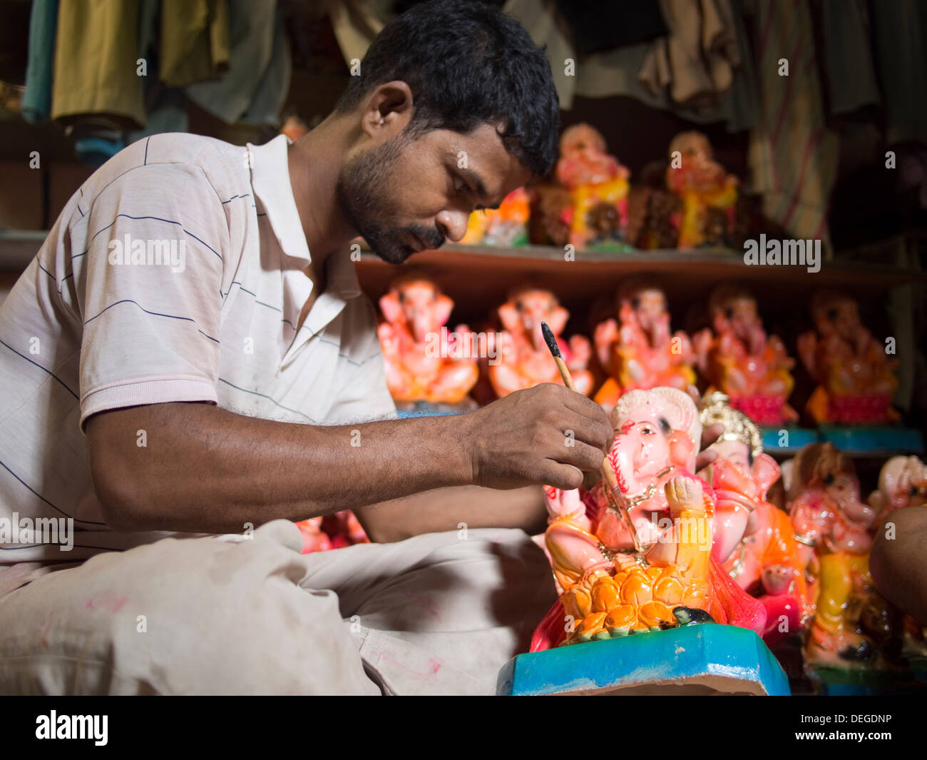 A Ganesha statue is painted before the Ganesha Chaturthi festivities, in Ahmedabad, India. - Stock Image