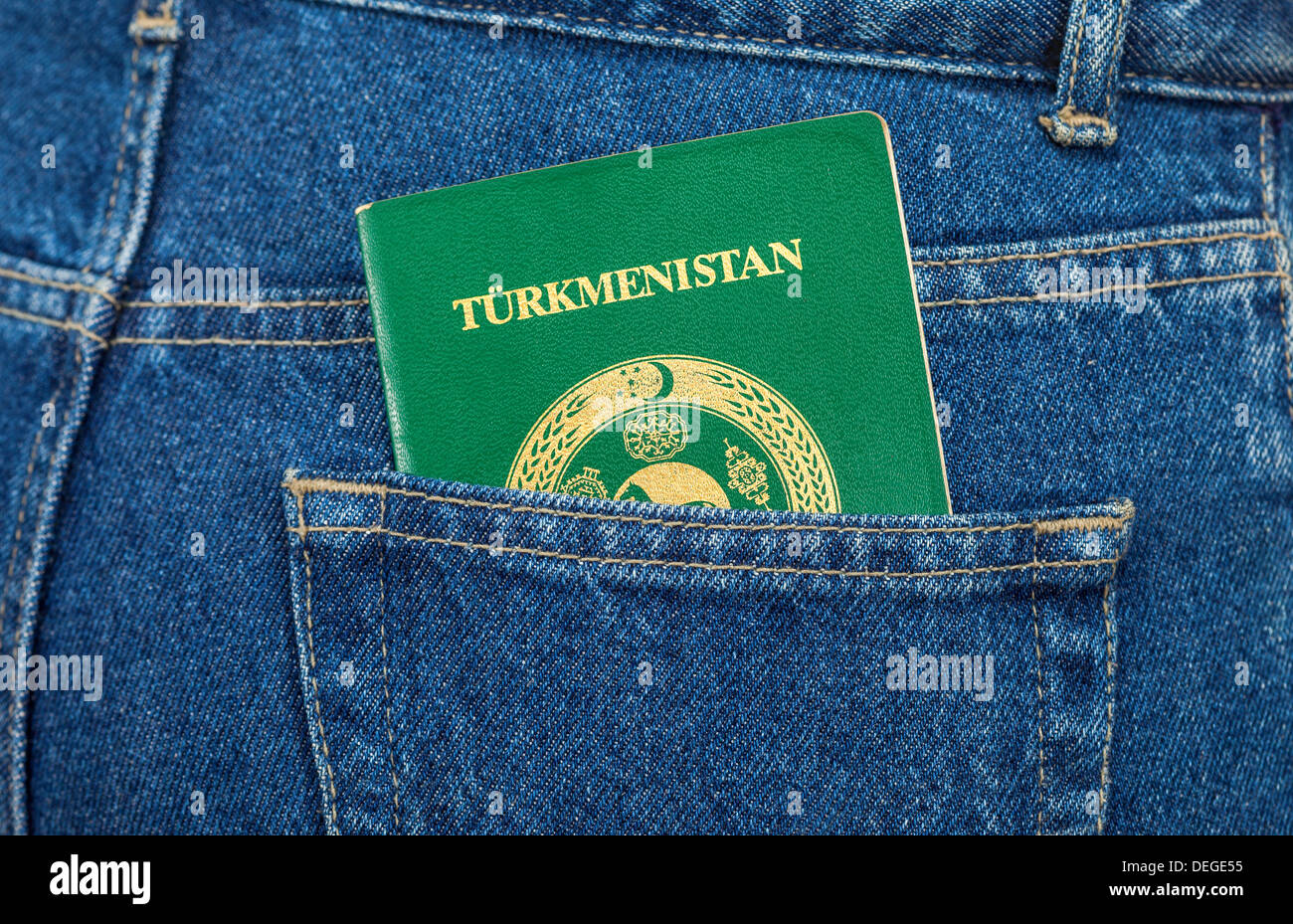 Turkmenistan passport in the back jeans pocket - Stock Image