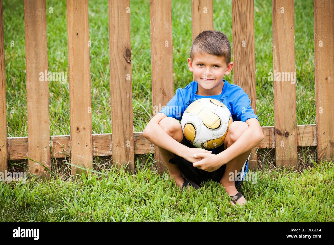 boy holding soccer ball - Stock Image