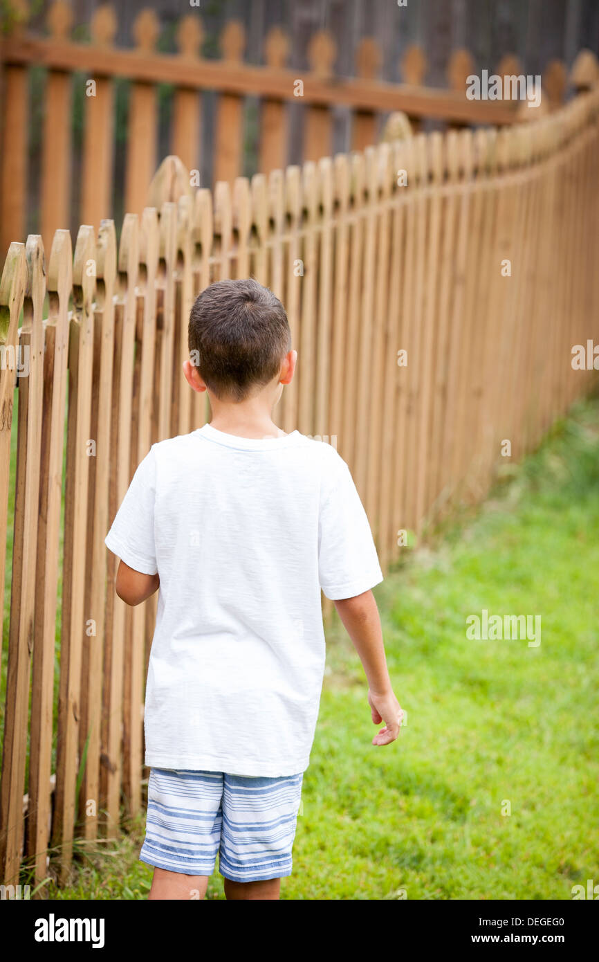 boy walking away - Stock Image