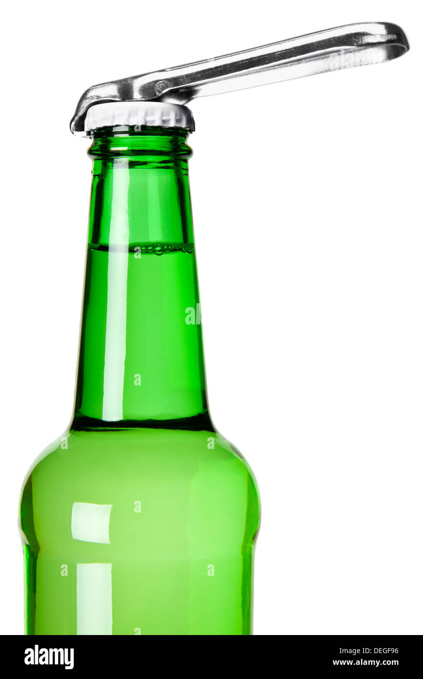 A bottle opener on top of a beer bottle. - Stock Image