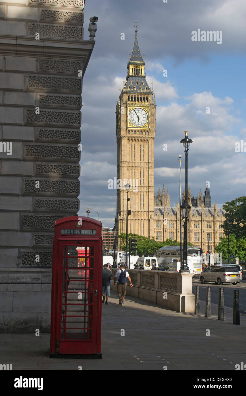 Big Ben, Palace of  Westminster, with a traditional English Red Telephone Box in the background, Central London, England, UK - Stock Image