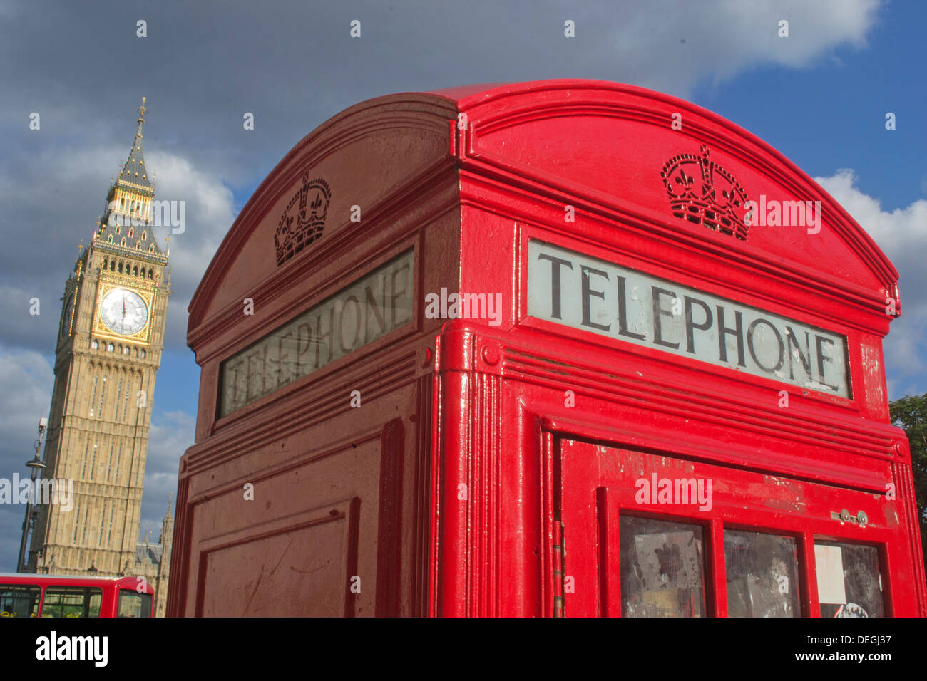 Traditional English Red Telephone Box, with Big Ben in the background, Westminster, Central London, England, UK - Stock Image