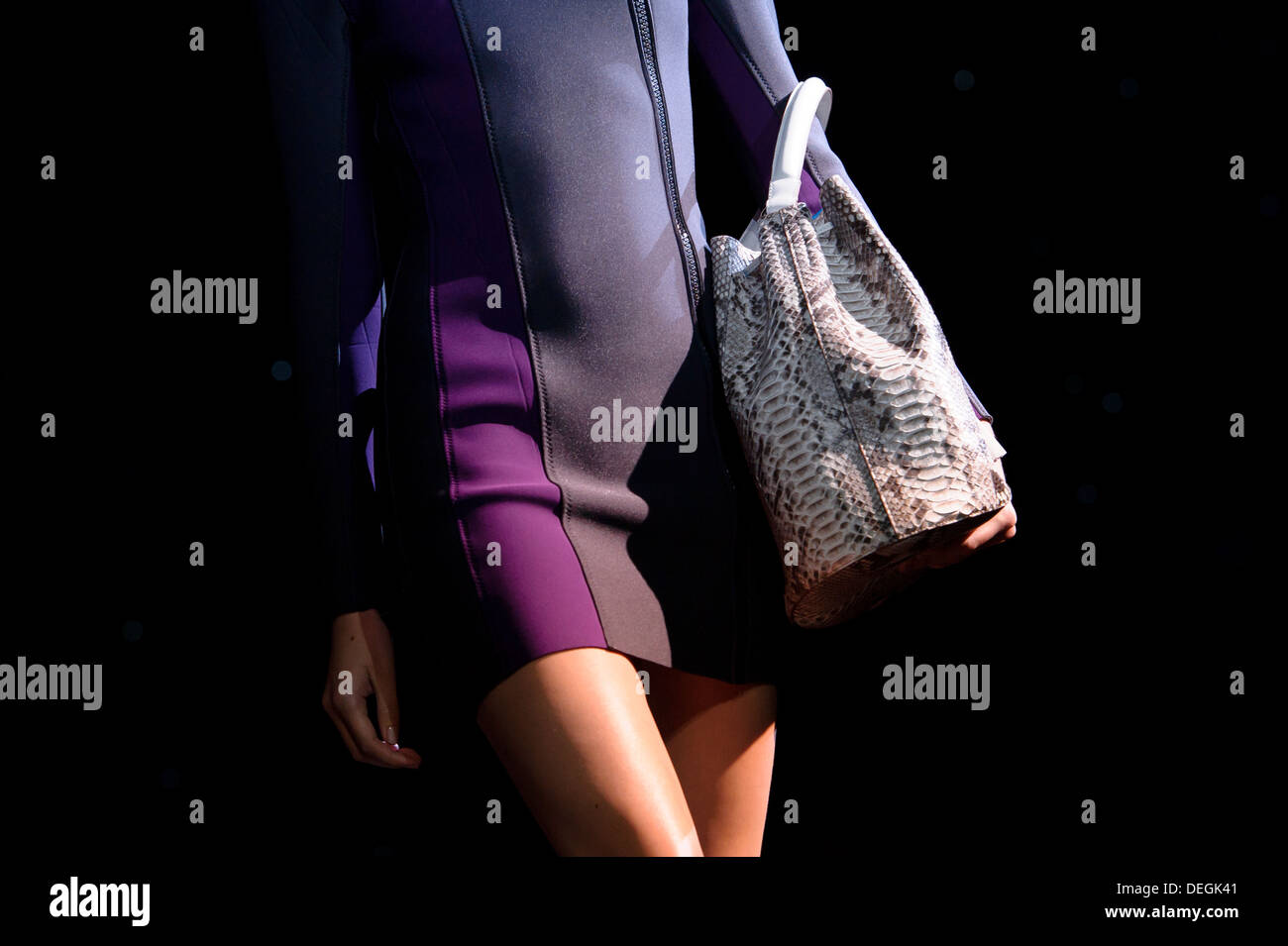 A model wears an accessory created by Anya Hindmarch during London Fashion Week Spring/Summer 2014. - Stock Image