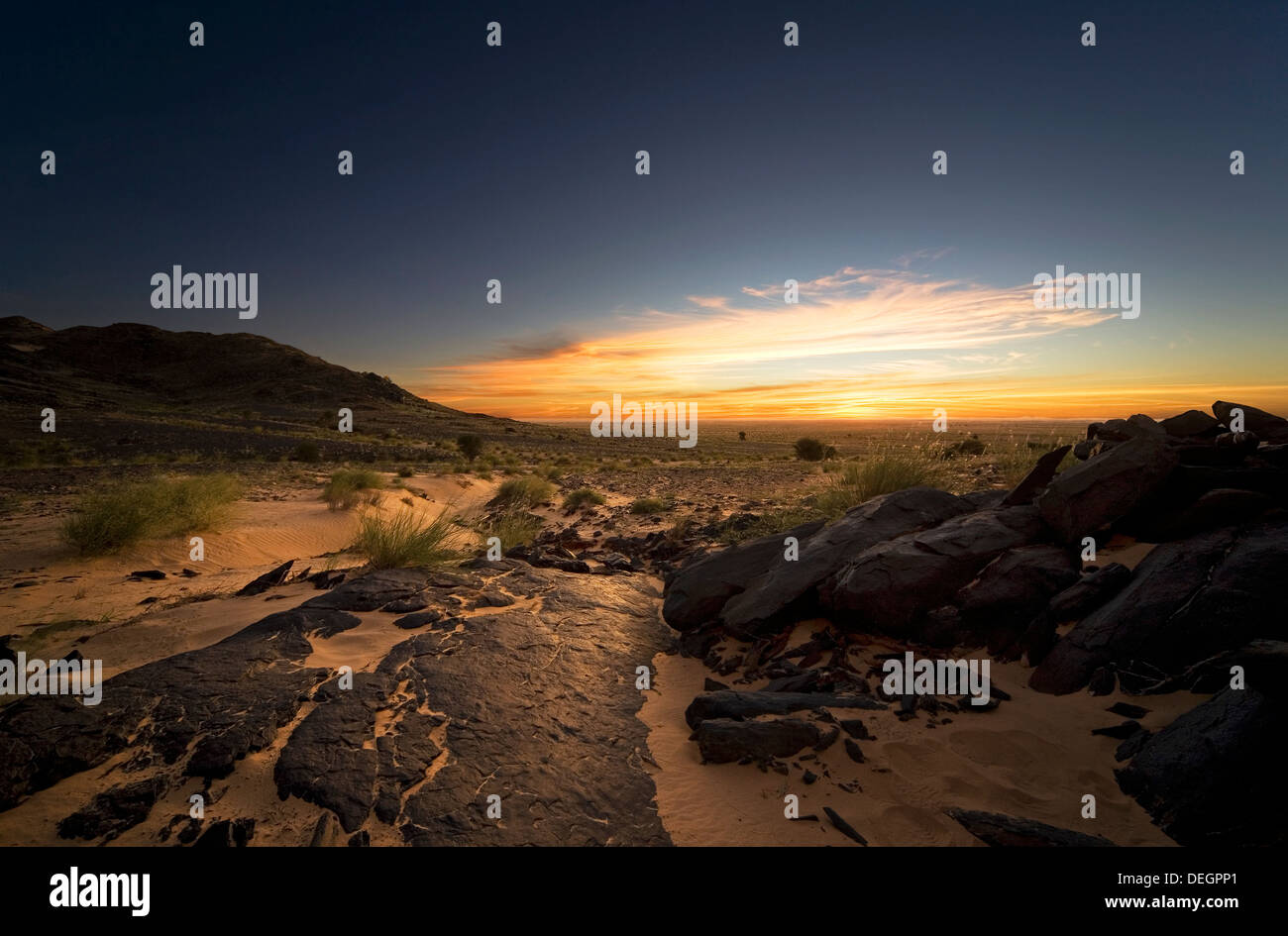 Dawn over granite rocky outcrop in hill location, Western Sahara desert, Mauritania, NW Africa - Stock Image