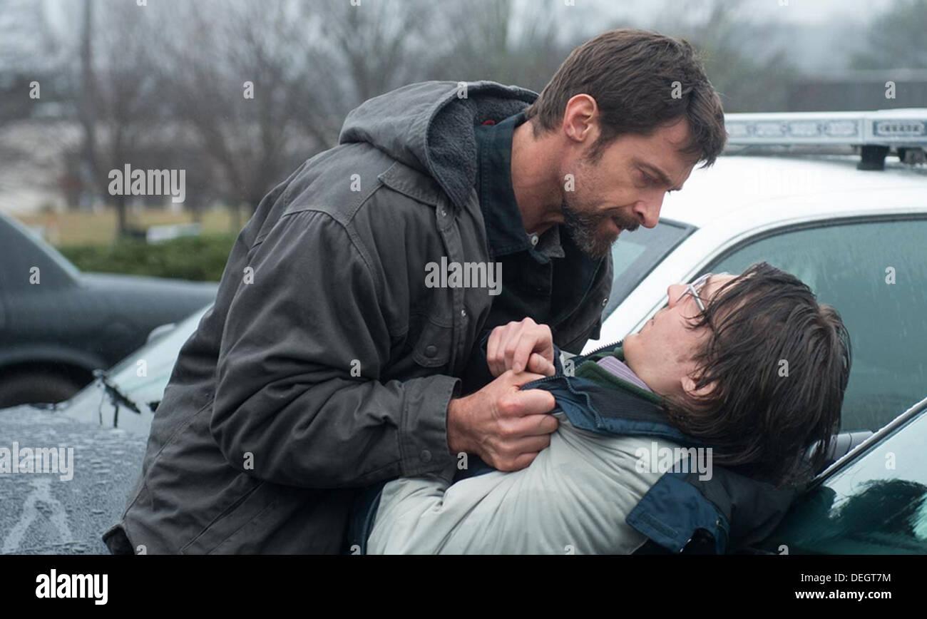 PRISONERS 2013 Warner Bros film with  Hugh Jackman as Keller Dover at left and Paul Dano as Alex jones Stock Photo