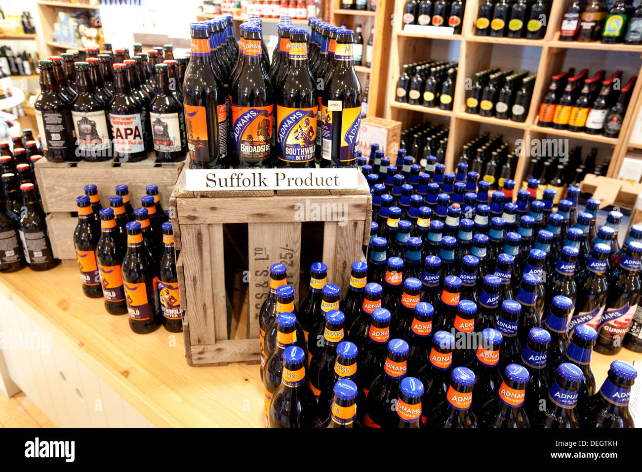 Local Produce - bottles of Adnams beer ale on sale, Snape Maltings store, Suffolk England UK - Stock Image