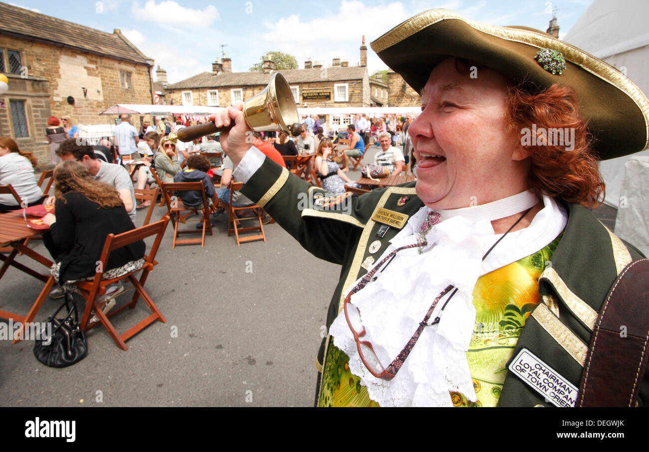 Town crier, Brenda wilson calls announcements at the inaugural Bakewell Baking Festival, Peak District, Derbyshire , 2013 - Stock Image