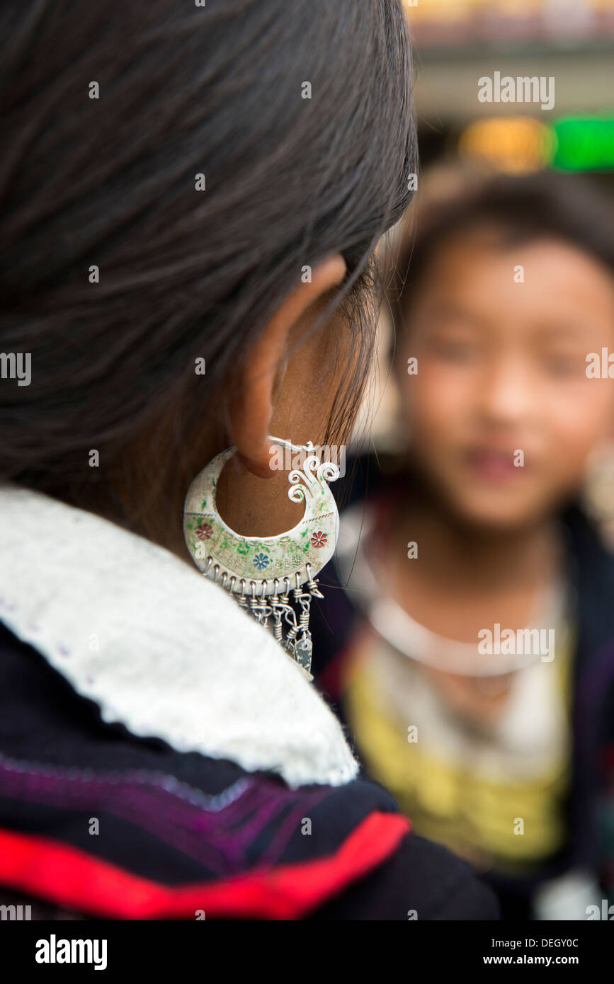 Little girl show traditional earring made by silver, Sa Pa, Vietnam - Stock Image