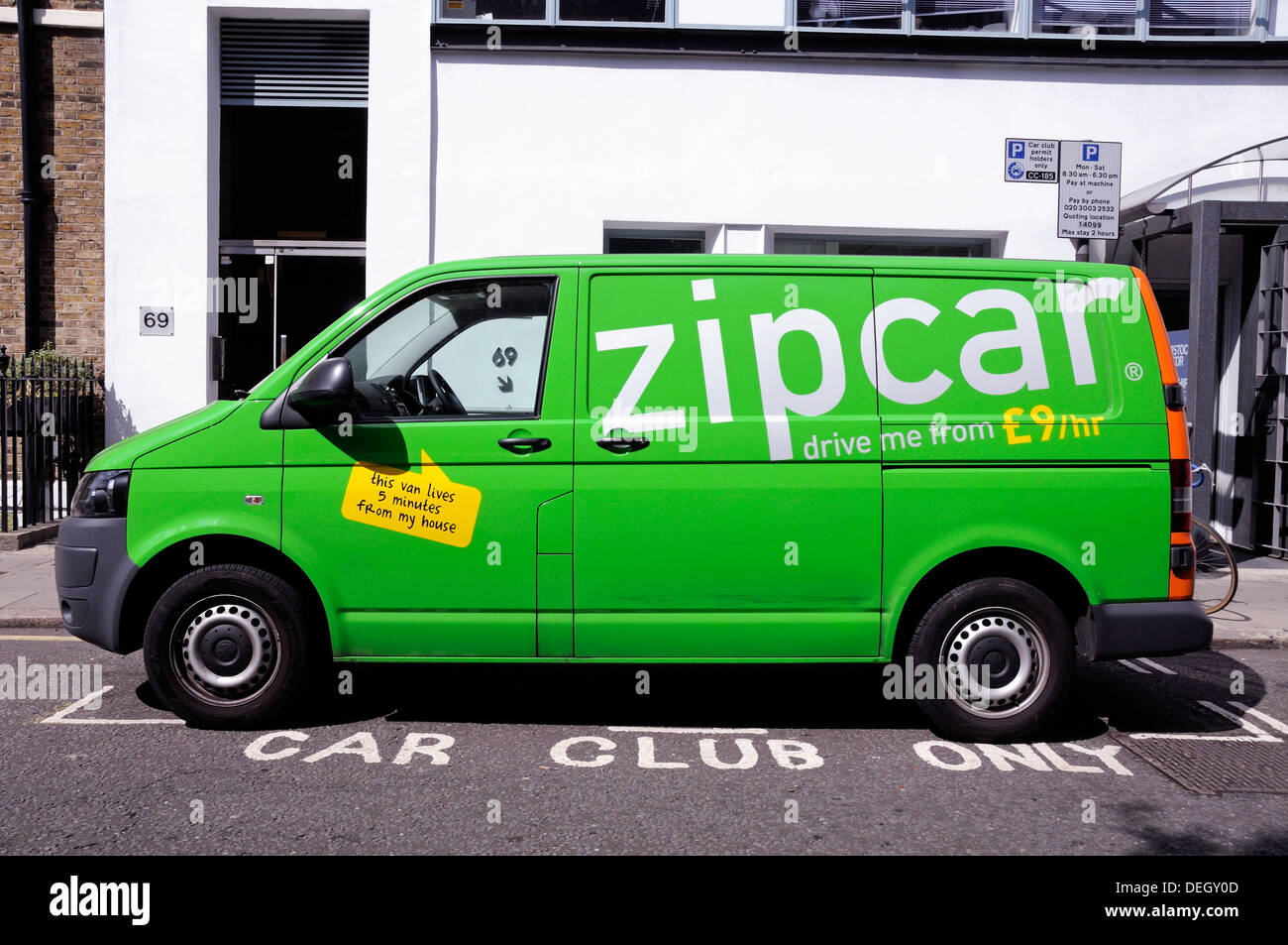Green Zipcar Van parked in car club parking bay, Central London, England, UK - Stock Image