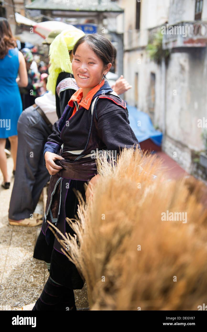Portrait of Black Hmong lady in Sa Pa sun day market, Sa Pa, Vietnam - Stock Image
