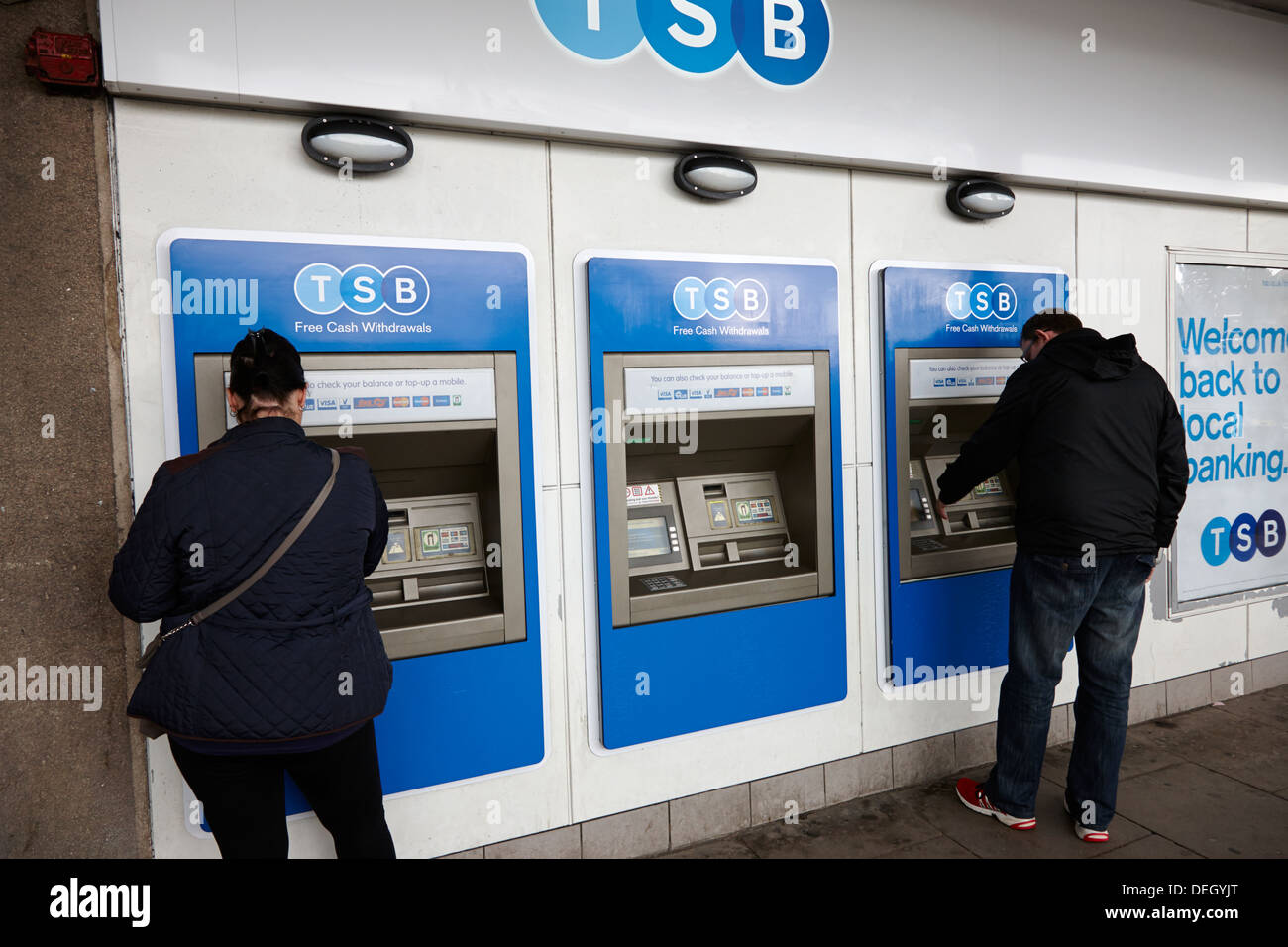 customers using cash machines of newly reopened TSB bank retail bank in the uk - Stock Image
