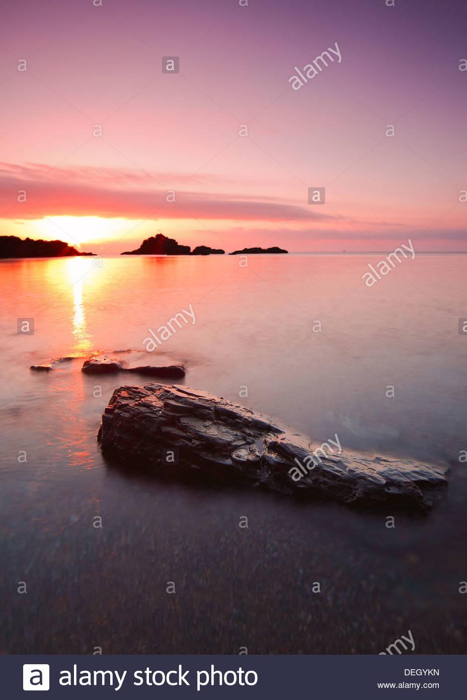 Rising sun at Cabo de Palos, Murcia, Spain - Stock Image