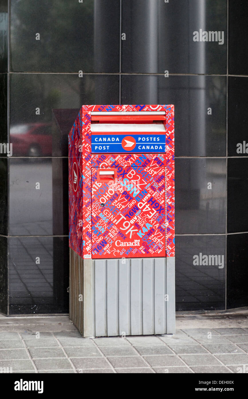 Post box of the Canadian postal system is covered in postal (zip) codes - Toronto, Canada - Stock Image