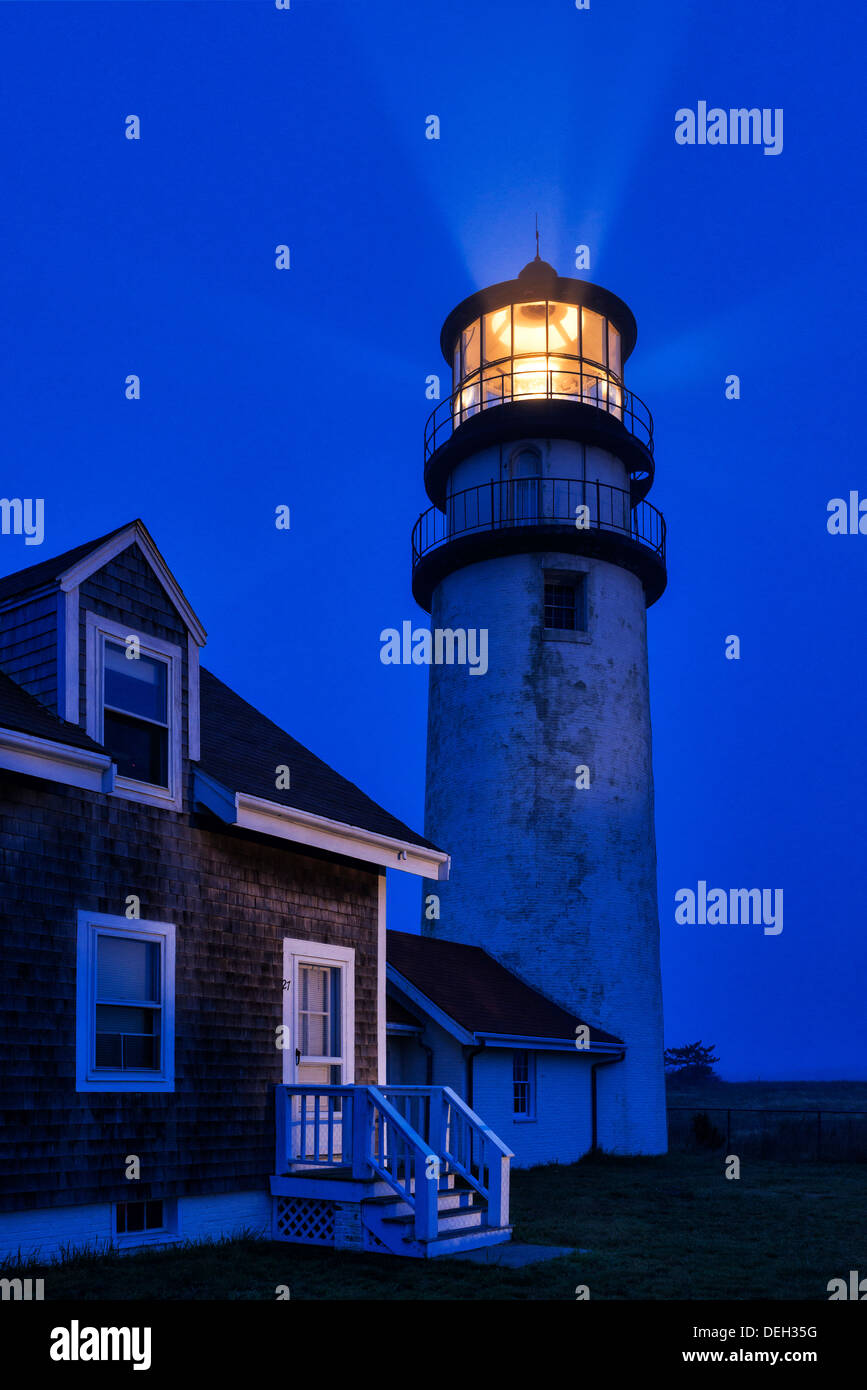 Ligthouse casts guiding light into dark blue night, Truro, Cape Cod, Massachusetts, USA - Stock Image