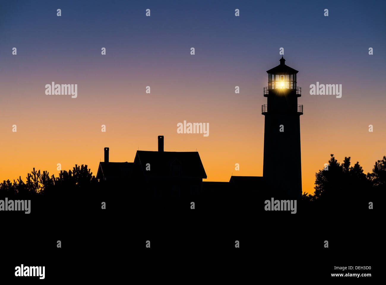 Sillhouette of a lighthouse at dawn, Highland Light, Truro, Cape Cod, Massachusetts, USA - Stock Image