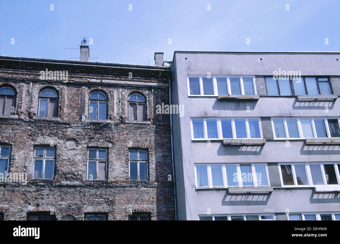 Surviving pre-war architecture next to post-war apartments. Prozna street. Warsaw. Poland - Stock Image