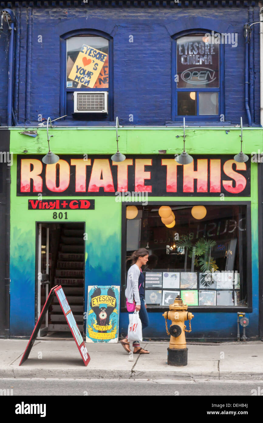 'Rotate This' - Shop sells old vinyl records (LPs, seven singles, CDs) and 'Eyesore' shop upstairs sells and rents movies - Stock Image