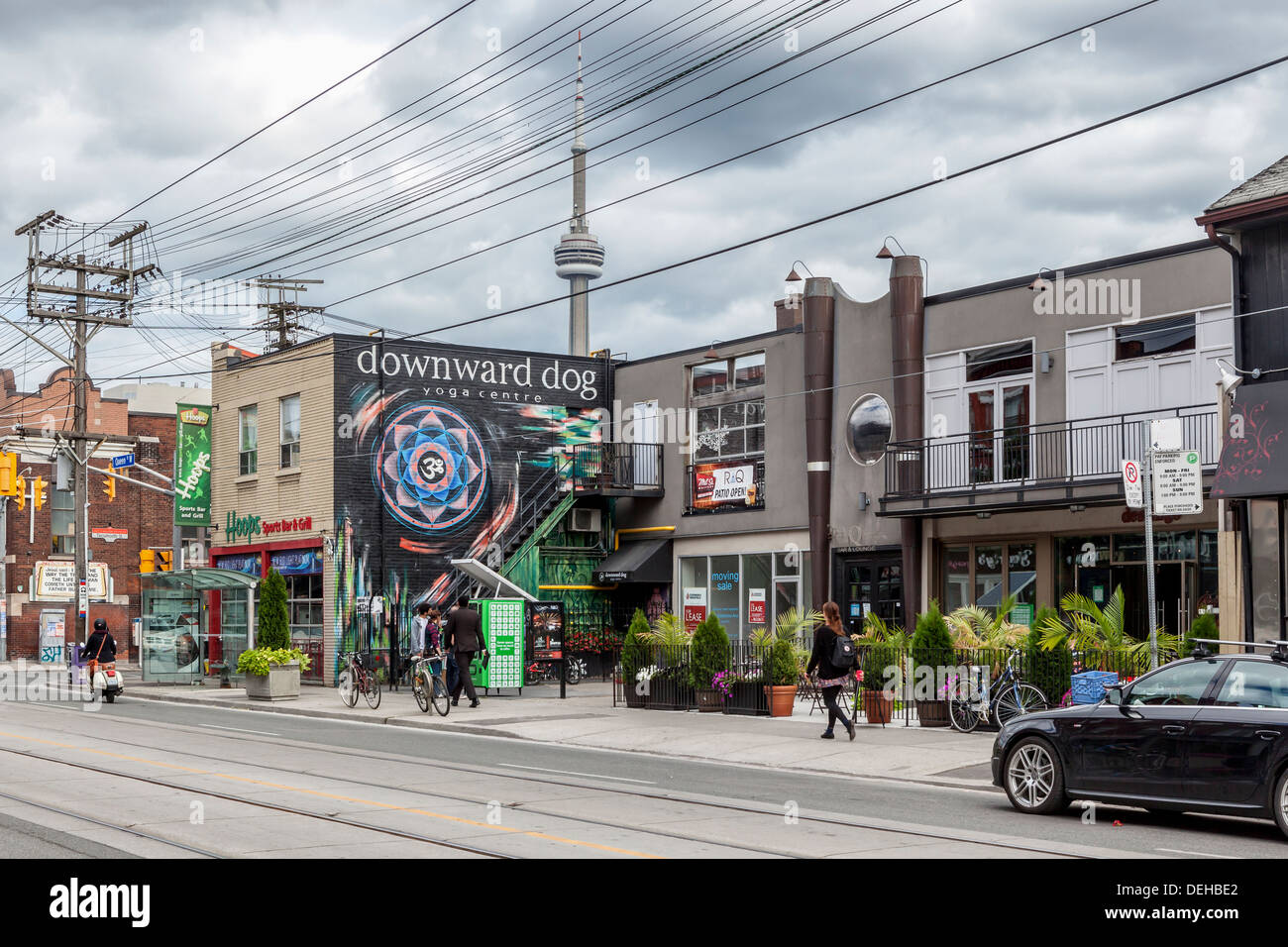 'Downward Dog' yoga centre and Hoops Sports bar and grill - Queen street West, Toronto - Stock Image