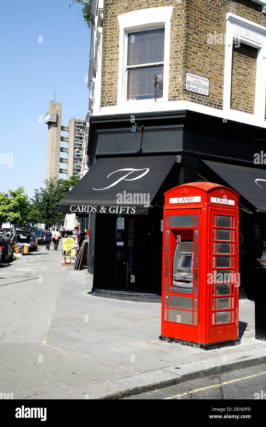 Telephone box converted into an ATM cashpoint on the corner of Golborne Road and Bevington Road, North Kensington, London, UK - Stock Image