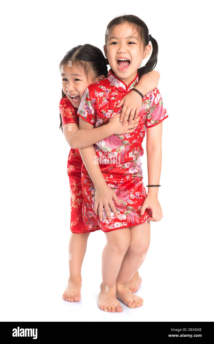 9aaa78515 Beautiful oriental Asian girls in traditional Chinese cheongsam playing,  full length isolated on white background