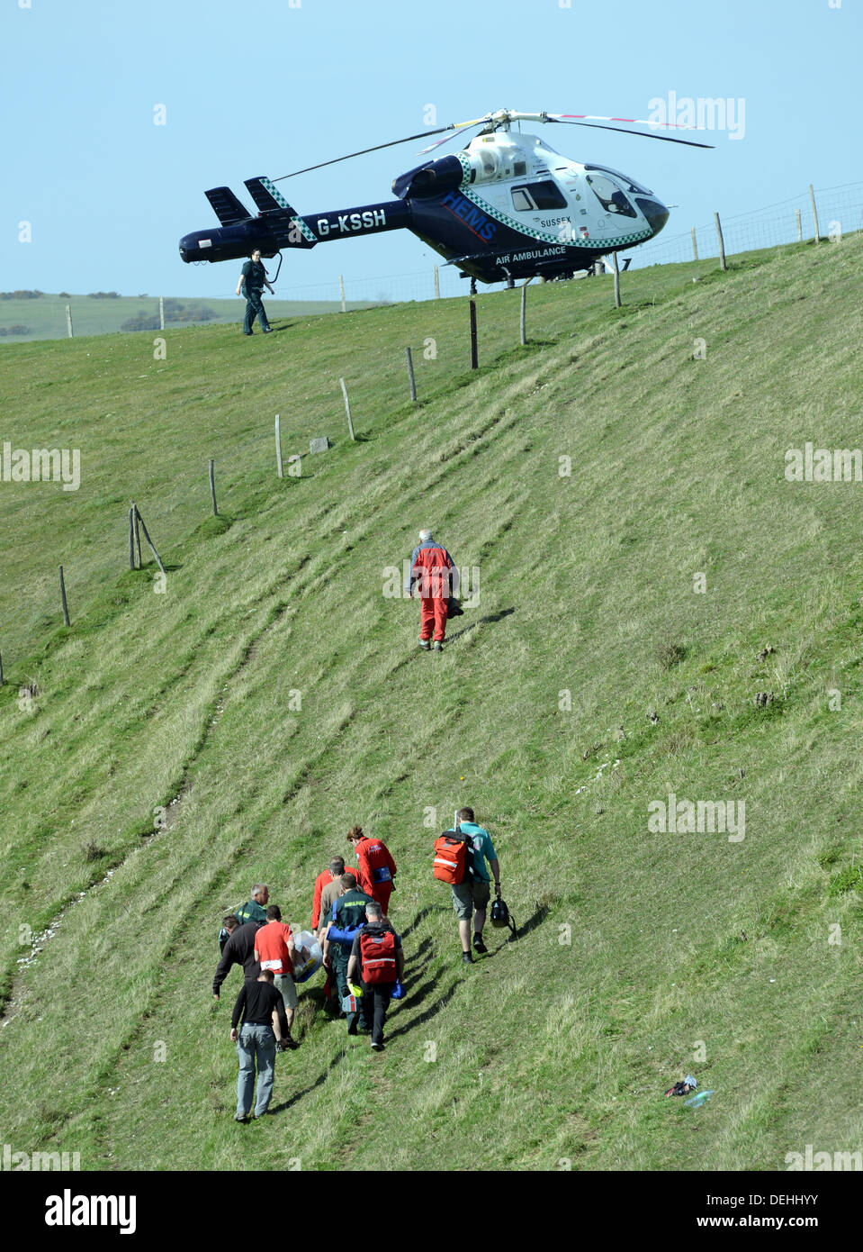 Kent Air Ambulance attending the scene of a paraglider crash, Mount Caburn, Lewes East Sussex - Stock Image
