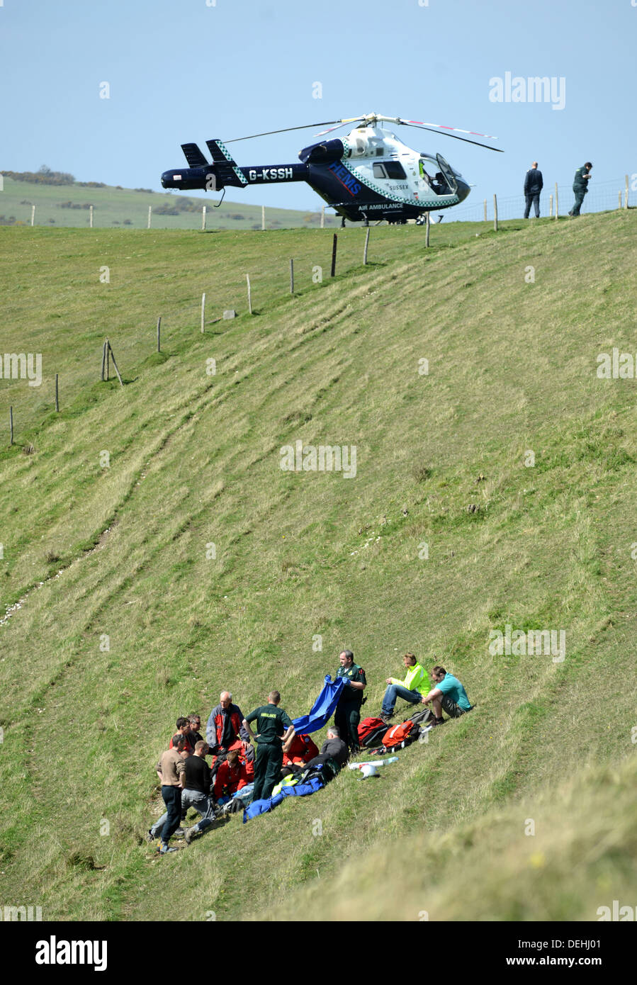 Kent Air Ambulance attending the scene of a paraglider crash, Mount Caburn, Lewes East Sussex Stock Photo