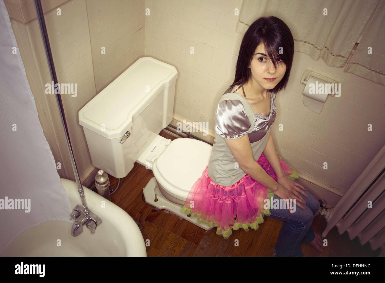Young Girl Sitting On Toilet Stock Photos & Young Girl