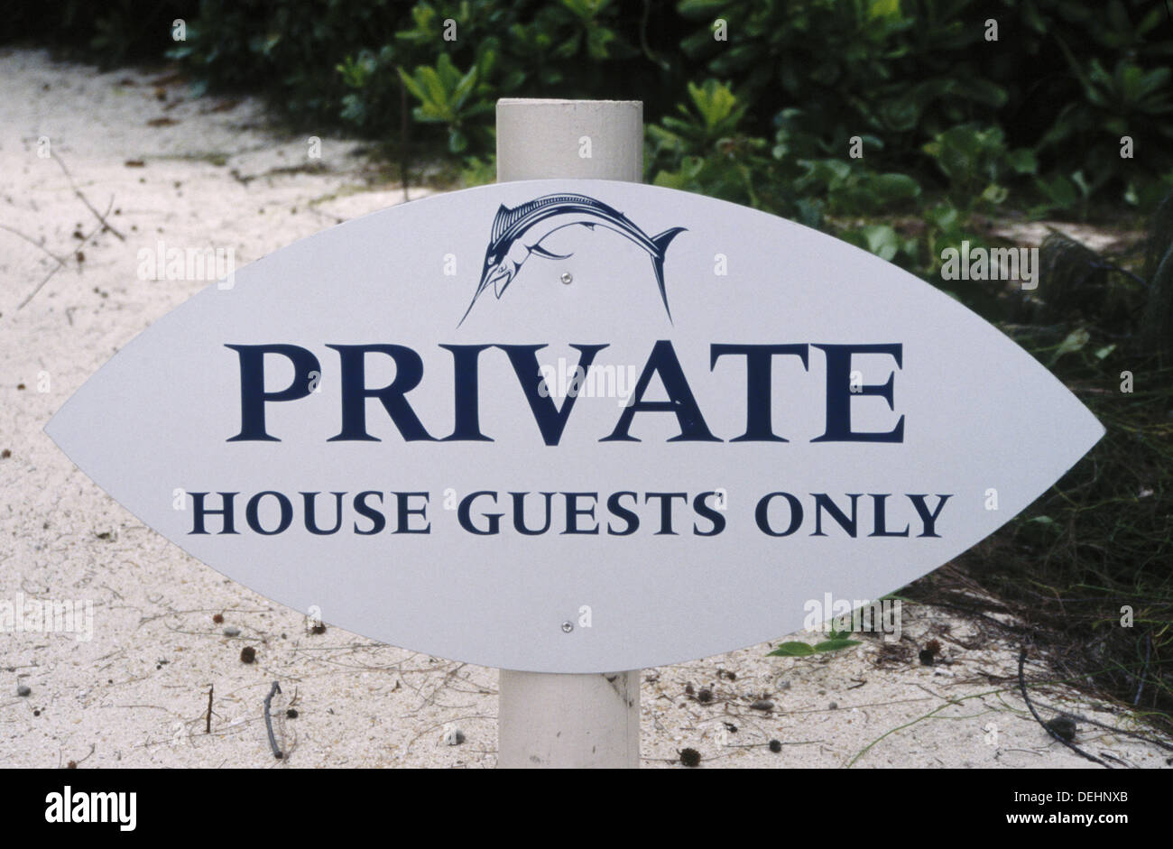 Private - house guests only. Only people staying at this exclusive resort can access the beach. - Stock Image